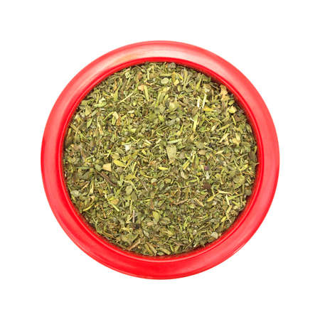 Top view of a red dish filled with Italian seasoning isolated on a white background.