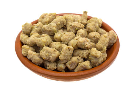 italian sausage: A portion of crumbled Italian sausage in a small bowl isolated on a white background.