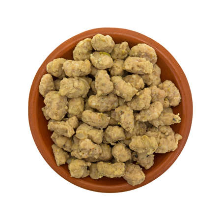 italian sausage: Top view of a portion of crumbled Italian sausage in a small bowl isolated on a white background.