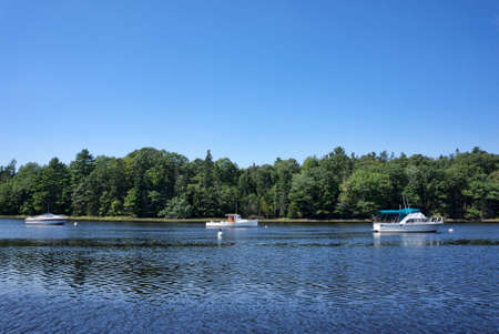 lobster boat: Three boats moored on Union River at Ellsworth Maine in the summertime.