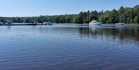 lobster boat: Boats moored and tied at dock on Union River at Ellsworth Maine in the summertime.