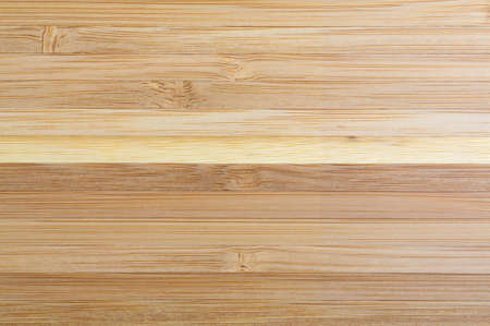 table top: Top view of a large wood laminated table top illuminated with natural light.
