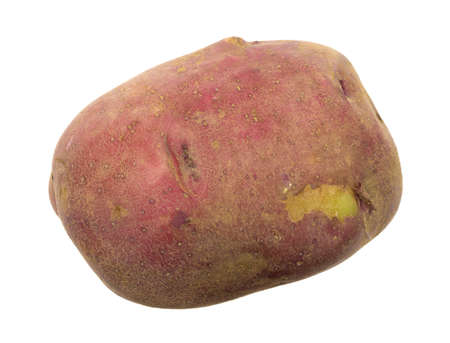 Top view of an organically grown red potato with a skin blemish isolated on a white background.
