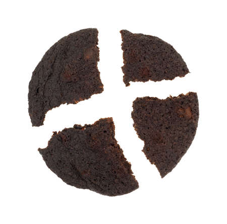 broken: A crispy chocolate chip brownie cookie broken into four pieces on a white background.