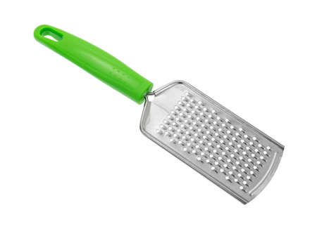inexpensive: A new inexpensive cheese grater with a green handle isolated on a white background.