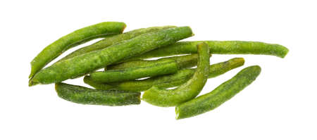 green been: A group of green beans that have been dehydrated and salted on a white background. Stock Photo