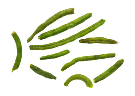 green been: Top view of green beans that have been dehydrated and salted arranged on a white background. Stock Photo