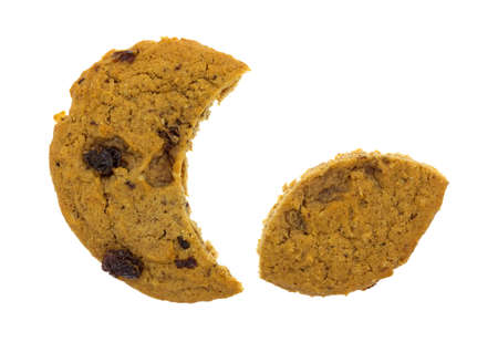sectioned: A large oatmeal raisin cookie with a portion removed for a crescent shape plus the remainder of the cookie arranged so the cookie is appearing to eat a smaller cookie on a white background.