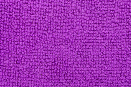 bright housekeeping: A very close view of a purple microfiber kitchen sponge. Stock Photo