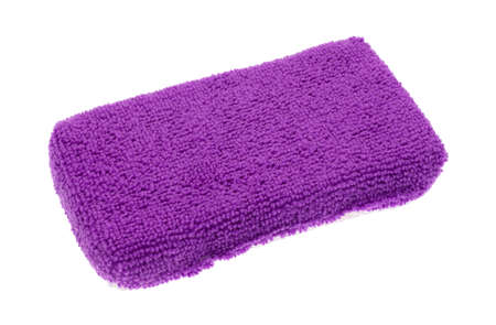 bright housekeeping: A new purple microfiber kitchen sponge isolated on a white background.