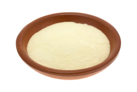 A portion of gluten free xanthan gum in a small bowl isolated on a white background.