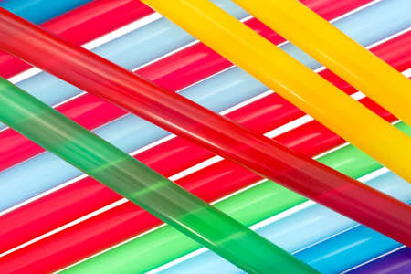 jumbo: Close view of a jumble of jumbo sized colorful drinking straws for smoothies and milkshakes. Stock Photo