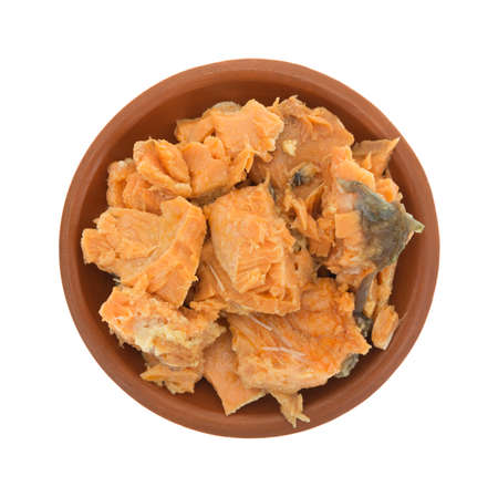 terra cotta: Top view of a portion of canned salmon in a small terra cotta dish isolated on a white background. Stock Photo