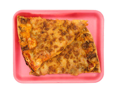 Top view of two slices of day old pizza on a pink foam butcher tray isolated on a white background.