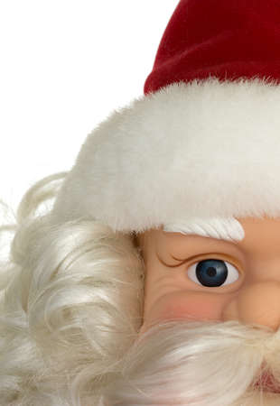 partial: A partial view of an old Santa Claus plastic doll face decoration with hat and beard.