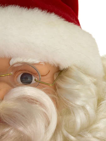 partial: A partial view of an old Santa Claus plastic doll face decoration with red hat, glasses and white beard. Stock Photo