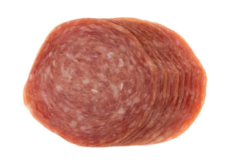 Top view of several slices of genoa salami on a white background.