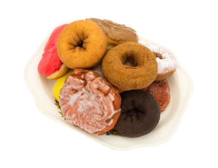 fritter: An old platter with several donuts and an iced cherry fritter isolated on a white background. Stock Photo