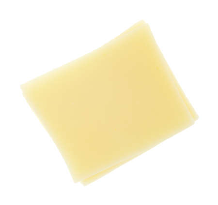 Top view of square slices of provolone cheese isolated on a white background. Stock Photo