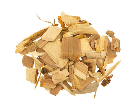 flavoring: Top view of a group of apple wood chips for flavoring barbeque and grilled foods isolated on a white background.