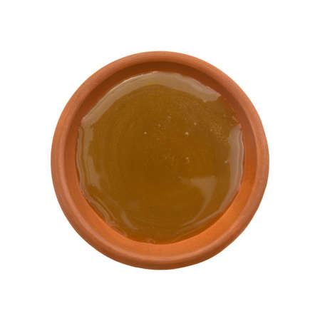 Top view of a portion of caramel candy topping in a small bowl isolated on a white background. Stock fotó