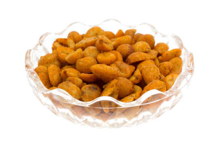 A small glass bowl filled with hot and spicy peanuts isolated on a white background.