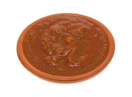 marinara sauce: A serving of marinara sauce in a small bowl isolated on a white background.