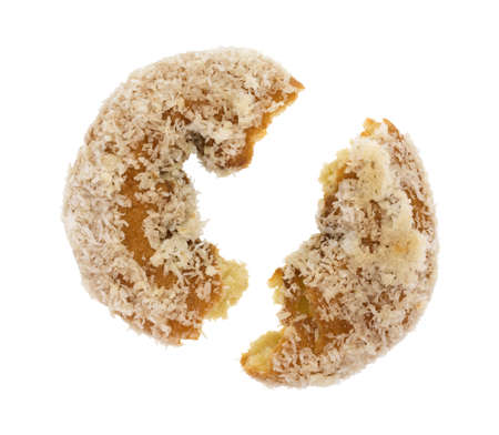 flaked: A coconut flaked plain donut broken in half isolated on a white background.
