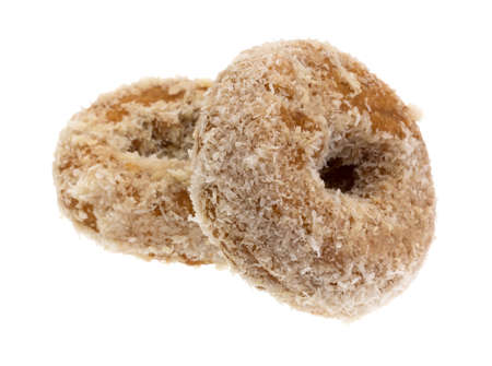 flaked: Two coconut flaked plain donuts isolated on a white background.