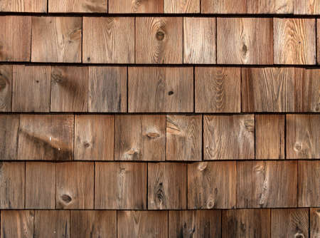 wall covering: Rows of red cedar on an exterior wall weathered by exposure. Stock Photo