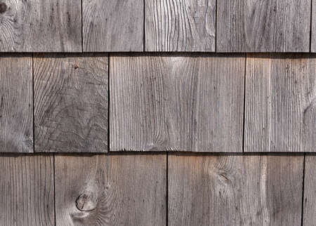 graying: Rows of graying red cedar on an exterior wall weathered by exposure. Stock Photo