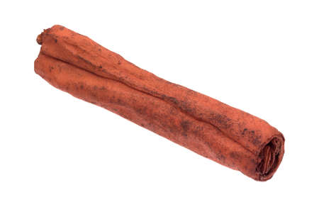 rawhide: Side view of a dyed red rawhide fetch stick for dogs isolated on a white background.