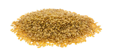 Side view of a small portion of organic golden flaxseed isolated on a white background. Фото со стока