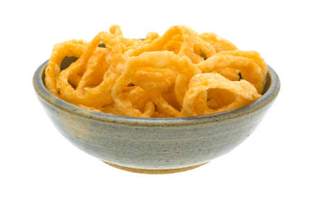 stoneware: A large serving of crunchy onion rings in an old stoneware bowl isolated on a white background. Stock Photo