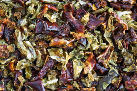 bell peppers: A very close view of chopped and dried red and green bell peppers.