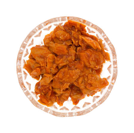 pink salmon: Top view of a small glass bowl of spicy flavored pink salmon isolated on a white background.