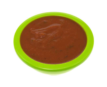 Side view of a bowl of pizza sauce isolated on a white background.