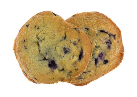 blueberry muffin: Top view of two freshly baked blueberry muffin tops isolated on a white background.