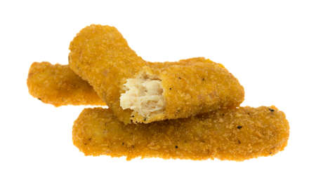 chicken fingers: Three chicken fingers with one broken in half isolated on a white background. Stock Photo