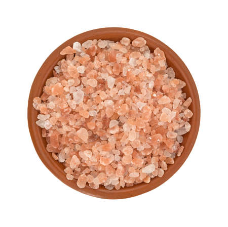 iron oxide: Top view of a portion of Himalayan pink salt in a small bowl isolated on a white background.
