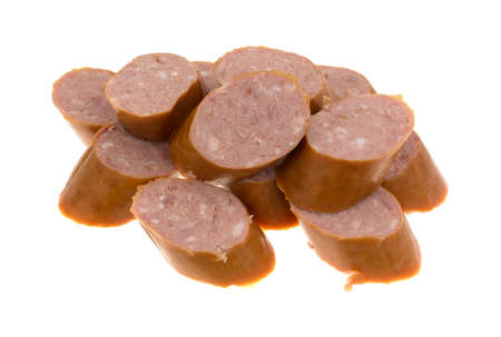 reduced: Several slices of reduced calorie kielbasa sausage isolated on a white background.