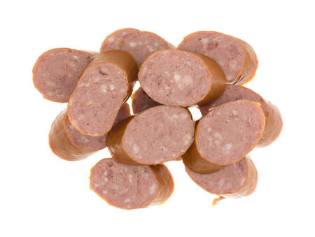 reduced: Top view of several slices of reduced calorie kielbasa sausage isolated on a white background. Stock Photo