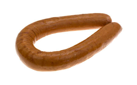 the calorie: A bent full length reduced calorie kielbasa sausage isolated on a white background. Stock Photo