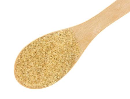 minimally: A spoonful of turbinado sugar on a white background.