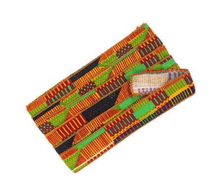 stitched: A folded length of African design sewing ribbon isolated on a white background.