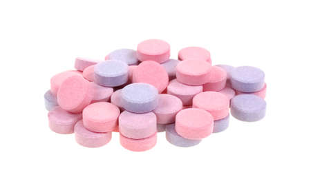 antacid: A group of berry flavored antacid calcium supplements tablets isolated on a white background. Stock Photo