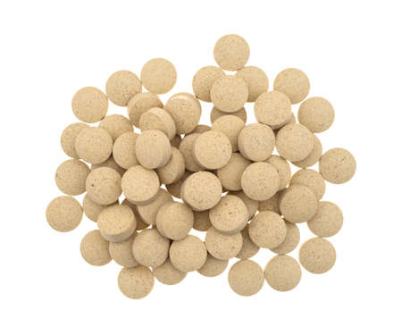 brewers: Top view of a group of brewers yeast nutritional supplement tablets isolated on a white background.
