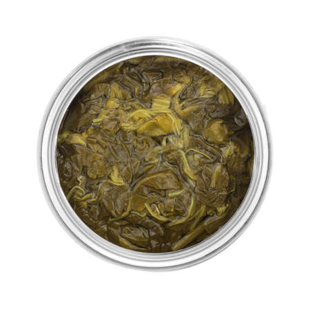 vegetable tin: Top view of an opened can of spinach isolated on a white background.