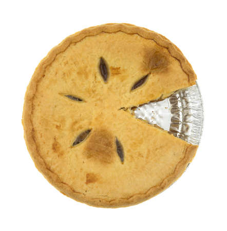 free dish: Top view of a sugar free apple pie with one slice cut in the tinfoil baking dish isolated on a white background.
