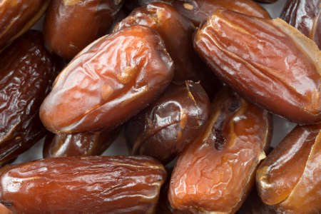 pitted: A very close view of Tunisian pitted dates on a plate.